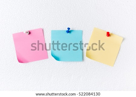 pink blue and yellow paper note with pin on foam sheet, concept remember and memory