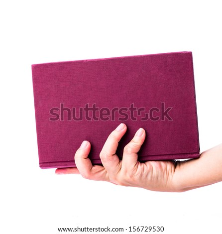Pink book with hand isolated on white background - stock photo