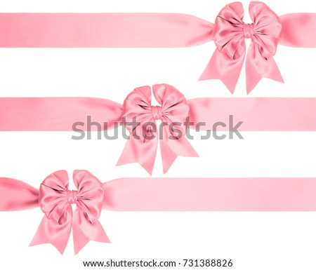 pink bow with tails on a wide ribbon from different sides to create a gift decoration