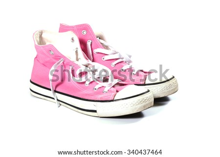 Pink canvas gym shoes on white background - stock photo