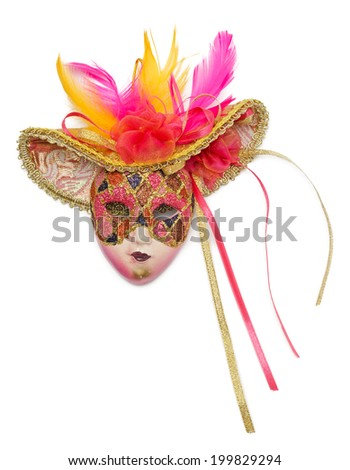 Pink carnival mask with feathers isolated on white background