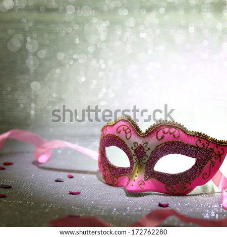 Pink carnival mask with glittering background - stock photo