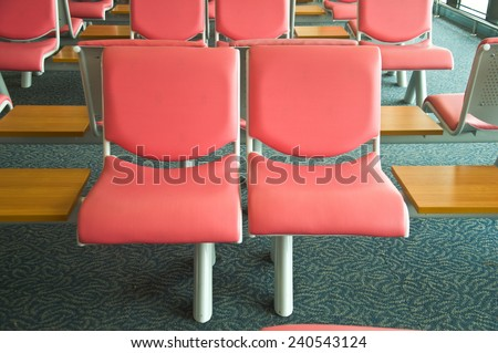 pink chair in the airport waiting room - stock photo