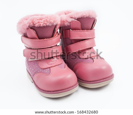 pink child boots white isolated