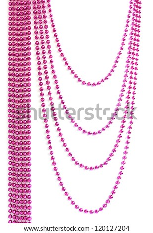 Pink Christmas bead garland hanging on white background - stock photo