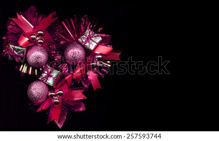 Pink Christmas decoration on a black background - stock photo