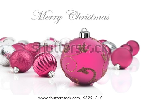 Pink christmas decorations on a white background with space for text - stock photo