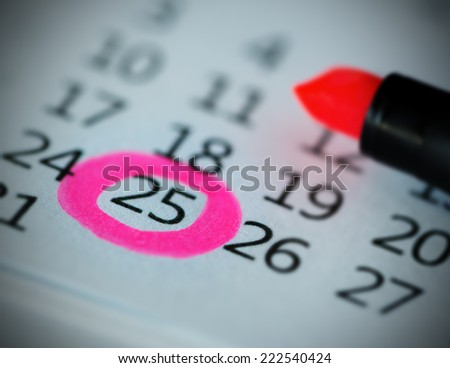 Pink circle. Mark on the calendar at 25. - stock photo
