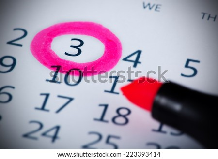 Pink circle. Mark on the calendar at 3. - stock photo
