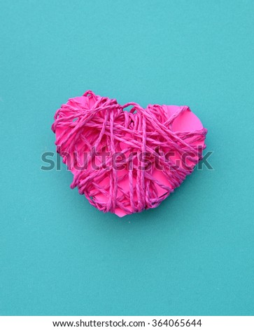 Pink clew in shape of heart (love concept) - stock photo