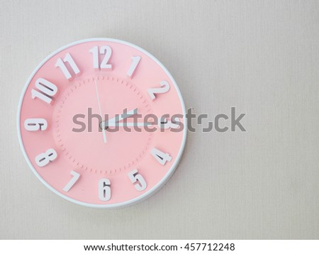 pink clock on he wall