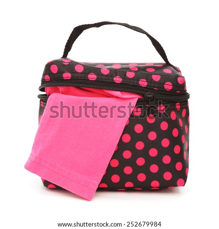 pink cloth in small vivid pink polka dot on black bag , white background