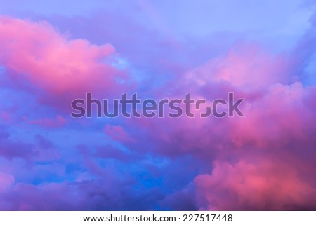 Pink clouds and blue sky - stock photo