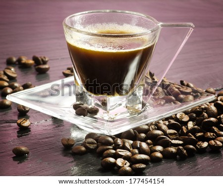 pink coffee break with coffee beans over ardesia - stock photo