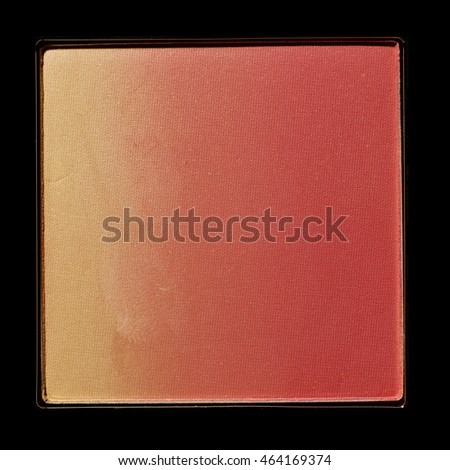 Pink color cosmetic in square shape on black background