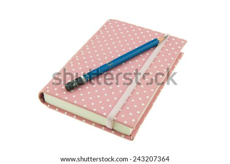 Pink color cover fabric note book and pencil isolated on white background