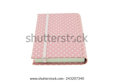 Pink color cover fabric note book isolated on white background