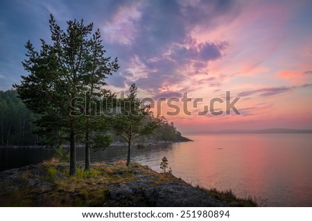 pink color of the lake and the sky at sunset - stock photo