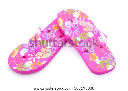 pink colored summer slippers isolated on white background