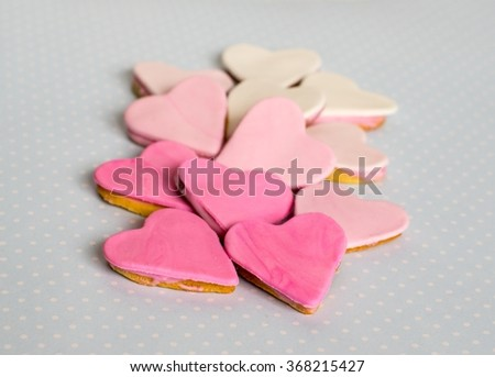 Pink cookies, heart shape, blue background
