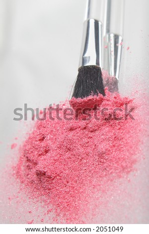 Pink cosmetic shimmer powder, vertical format with applicator brush - stock photo