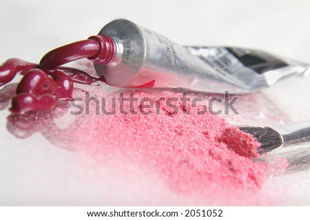 Pink cosmetics, spilled and smudged. - stock photo