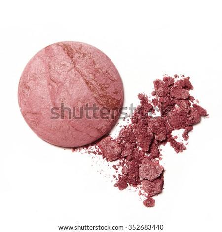 pink crumbled blush eyeshadow on white background - stock photo