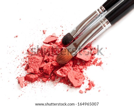 Pink crushed eyeshadow with brushes