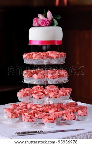 Pink cup cakes at a wedding reception
