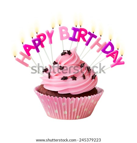 Pink cupcake decorated with birthday candles