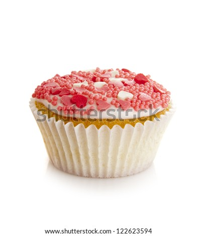 Pink cupcake isolated on white - stock photo
