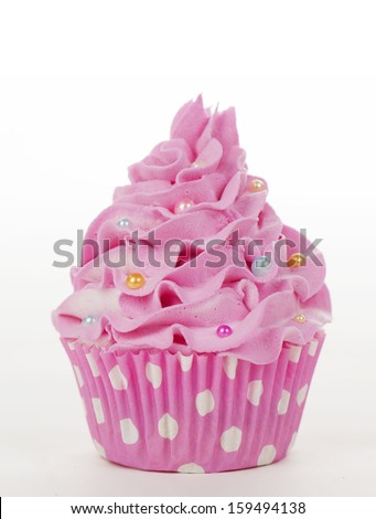Pink cupcake with sprinkles isolated on a whote background - stock photo