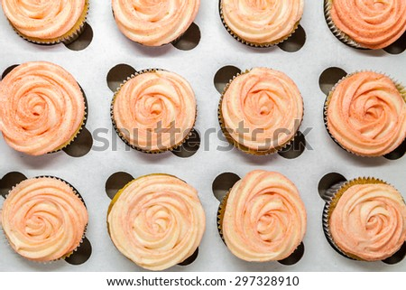 Pink cupcakes like a roses in a box for sweets - stock photo
