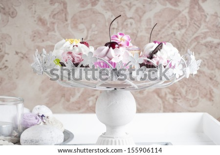 Pink Cupcakes on a cake stand - stock photo