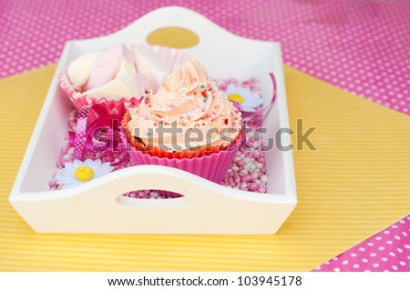 pink cupcakes with marshmallows on a diner plateau - stock photo