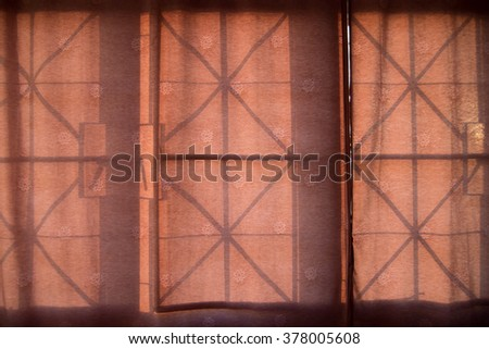 Pink curtains on a window with illumination. - stock photo