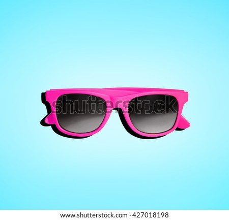 Pink cute sunglasses isolated on aqua blue background.  - stock photo