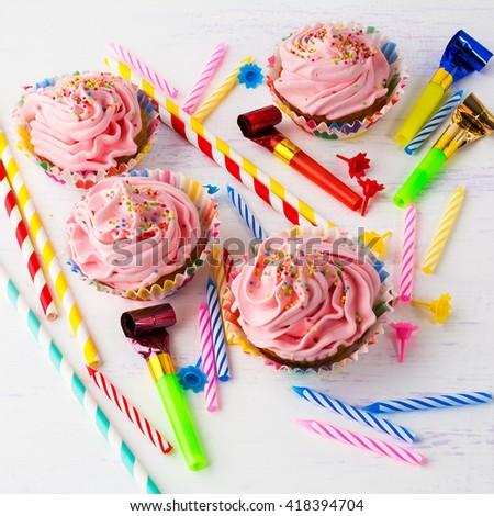 Pink delicious birthday cupcakes, square. Birthday cupcakes. Homemade cupcake. Sweet cupcake. Gourmet cupcakes. Sweet dessert. Sweet pastry. Birthday invitation.  - stock photo
