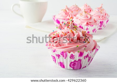 Pink delicious cupcakes and cup of tea. Birthday cupcakes. Homemade cupcake. Sweet cupcake. Gourmet cupcakes. Sweet dessert. Sweet pastry.  - stock photo