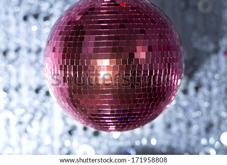 pink discoball with colured background - stock photo
