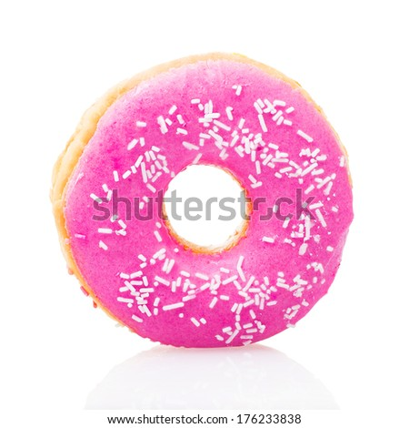 Pink donut on white background - stock photo