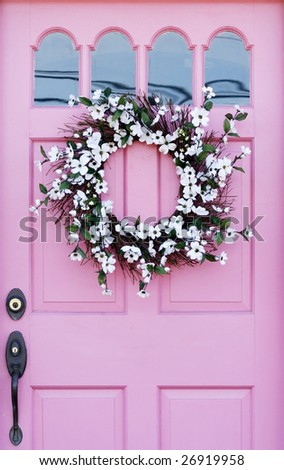pink door with wreath - stock photo