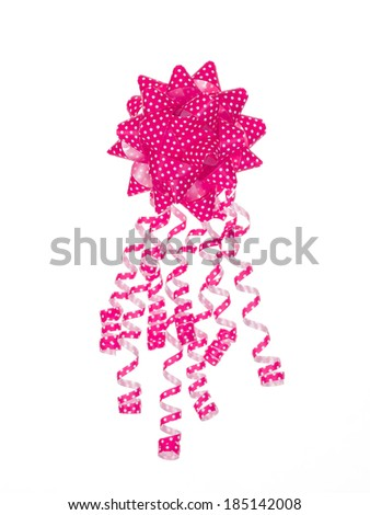 Pink dotted gift bow isolated on white background - stock photo