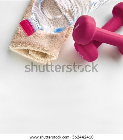 Pink dumbbells, towel and bottle of mineral water. Sport of women background. Square composition. Top view - stock photo