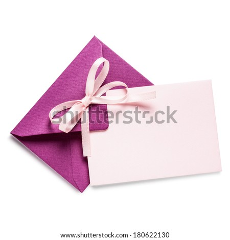 Pink envelope with card and bow ribbon on white background, clipping path included - stock photo