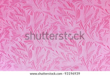 Pink fabric with floral ornament, background - stock photo