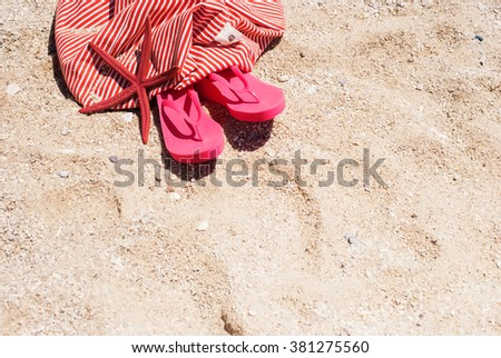 Pink Flip Flops Bag Starfish on Sand Beach Summer Holiday Concept Copy Space Background for Design - stock photo