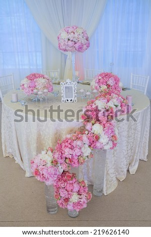 pink flower arrangements on a wedding table - stock photo
