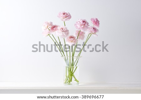 pink flower on the shelf