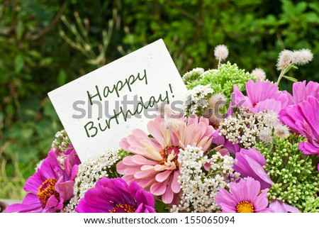 pink flowers and birthday card/happy birthday/english - stock photo
